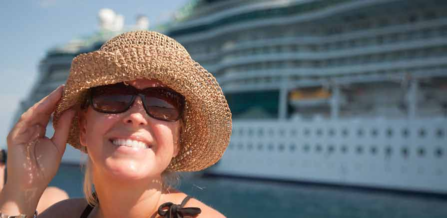 Cruise Ship Employee Poses in front of Cruise Ship Photo
