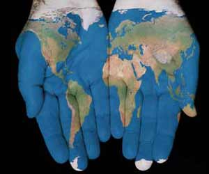 World Map Pained on Hands Image