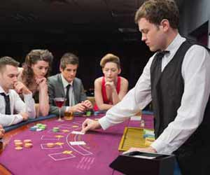 Casino Blackjack Dealer Deals Cards on Cruise Ship