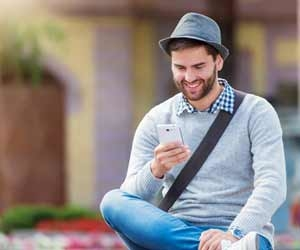 Man enjoying working in the sharing economy while checking smartphone