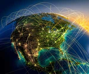 Air travel routes lit up on picture of glboe