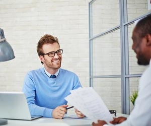 Hiring manager reviewing job candidate's resume